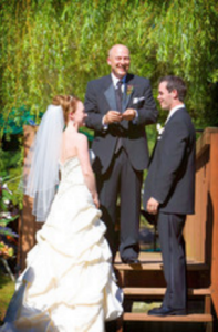 Photo of a wedding officiant performing a ceremony